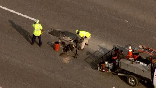 Crews working to repair a pot hole on EB I-44 Thursday (Credit: KMOV)