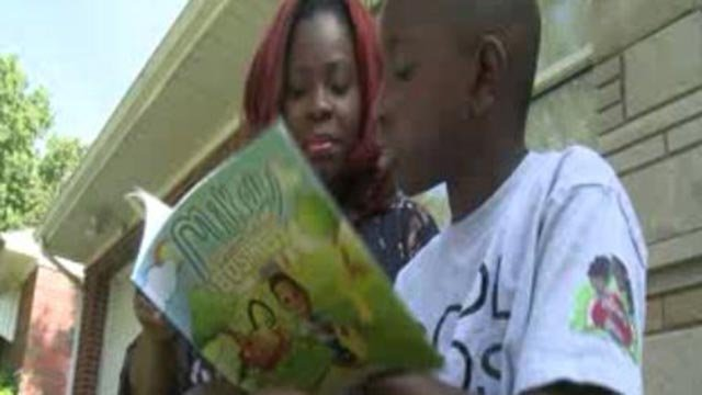 Michael 'Mikey' Wren, 10, reading 'Mikey learns about business' (Credit: KMOV)
