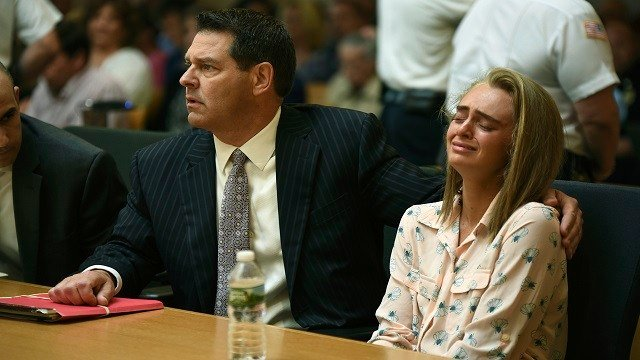 Michelle Carter seated with her attorneys Cory Madera and Joseph Cataldo reacts as she listens to Judge Lawrence Moniz before he finds her guilty of involuntary manslaughter in the suicide of Conrad Roy III, Friday, June 16, 2017 (AP Photo)