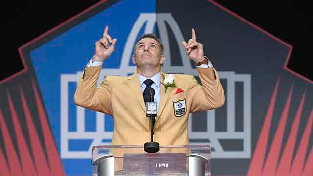 Former NFL quarterback Kurt Warner points to the sky at the end of his speech during inductions at the Pro Football Hall of Fame on Saturday, Aug. 5, 2017, in Canton, Ohio. (AP Photo/David Richard)