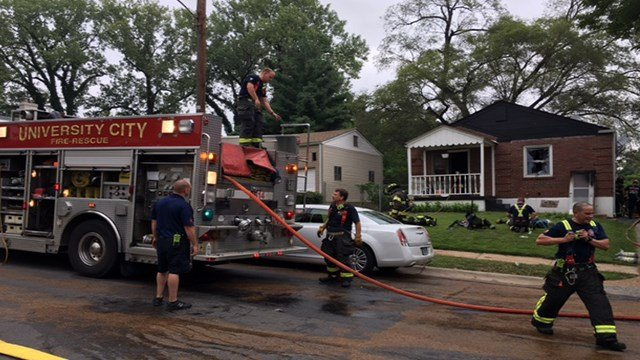 Firefighters worked to put out the flames from a fire at a home in University City Sunday evening. (KMOV)
