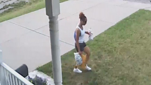 A woman was caught on camera stealing packages off of a Kirkwood couple's front porch. Now, the suspect's image is spreading quickly across social media sites to try and identify her. (Taken from security camera footage)