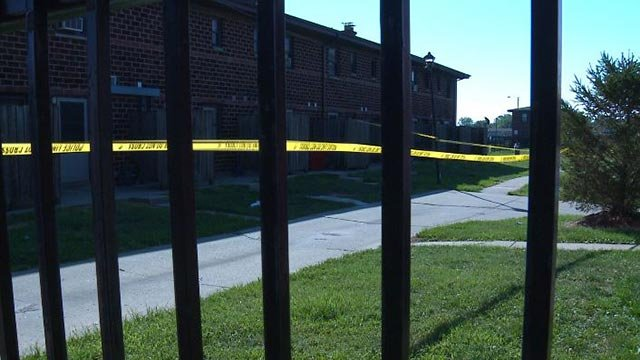 Crime scene tape around a building in the area of 12th and Bond Tuesday (Credit: KMOV)