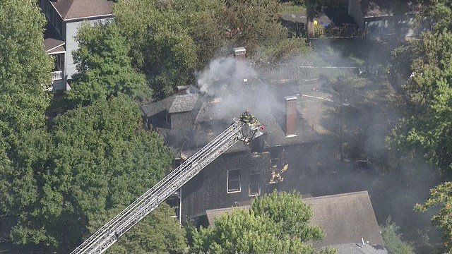 A two alarm house fire consumed a home in Webster Groves on Tuesday afternoon. (Credit: KMOV)