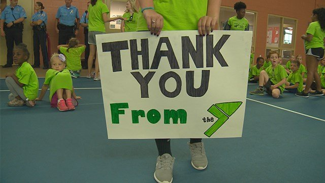 Kids at the YMCA Summer Camp in Edwardsville took time to honor first responders on the last day of camp. (KMOV)