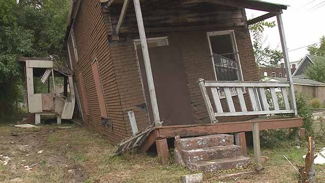 Resident Marty Spikener is worried about this leaning home on Dryden Avenue. Credit: KMOV