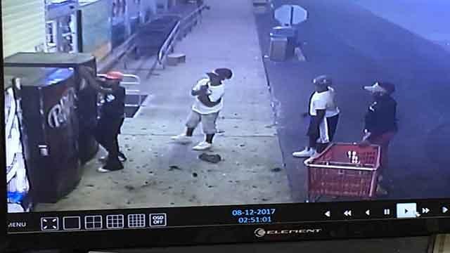 Surveillance footage captures four suspects damaging vending machines outside of Stelmacki's Market (Credit: St. Louis Metropolitan Police Department)