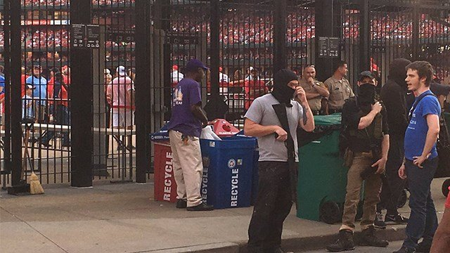 Groups of people started marching in protest in downtown St. Louis outside of Busch Stadium Saturday evening. (KMOV)
