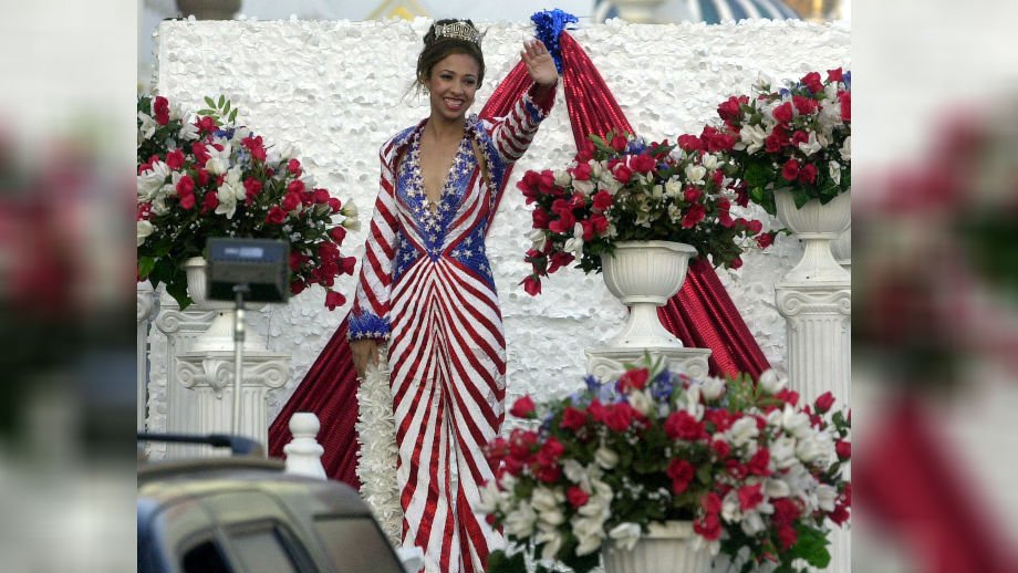 Miss America 2003 Erika Harold waves during the Miss America boardwalk parade in Atlantic City, N.J., Friday, Sept. 19, 2003. The parade went off as scheduled Friday evening despite threats from Hurricane Isabel. (AP Photo/Brian Branch-Price)