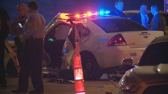 Officers Gary Glasby and Sheena Smith's patrol car was rammed near North Broadway outside of Wedge Tire. (Credit: KMOV)