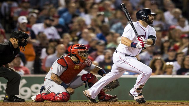 BOSTON, MA - AUGUST 15: Mitch Moreland #18 of the Boston Red Sox hits an RBI single during the fourth inning of a game against the St. Louis Cardinals on August 15, 2017 at Fenway Park in Boston, Massachusetts. (Photo by Billie Weiss/Boston Red Sox/Getty)