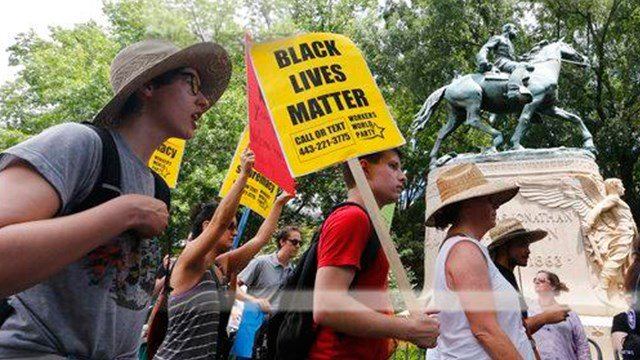 Protesters in front of a statue of Confederate General Stonewall Jackson (AP Photo/Steve Helber)