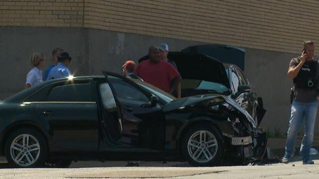 Two officers were injured in a crash at Morganford and Fyler Friday (Credit: KMOV)