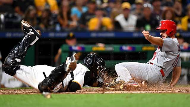 Paul DeJong #11 of the St. Louis Cardinals scores past Elias Diaz #32 of the Pittsburgh Pirates during the fifth inning at PNC Park on August 18, 2017 in Pittsburgh, Pennsylvania. (Photo by Joe Sargent/Getty Images)