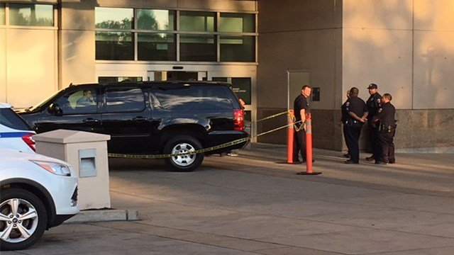 Police placed caution tape around Jame Clark's vehicle after he transported three shooting victims to the hospital. (KMOV)