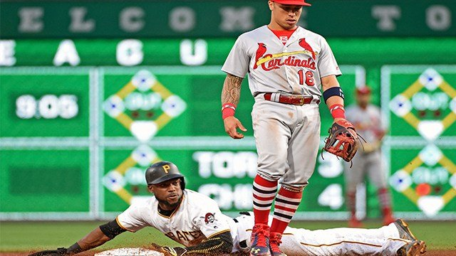 Pittsburgh Pirates' Starling Marte (6) slides into second base with a steal as St. Louis Cardinals' Kolten Wong (16) waits for a throw in the sixth inning. (AP)