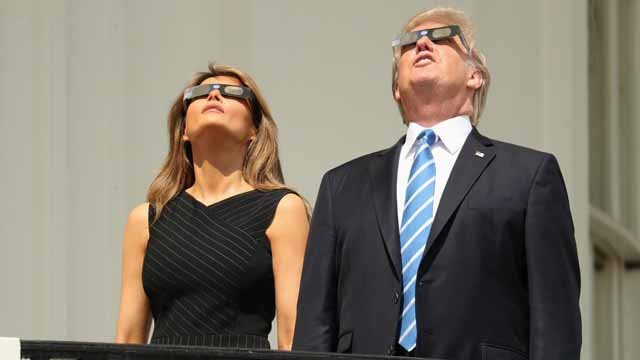 President Donald Trump and first lady Melania Trump wear protective glasses as they view the solar eclipse, Monday, Aug. 21, 2017, at the White House in Washington.  (AP Andrew Harnik)