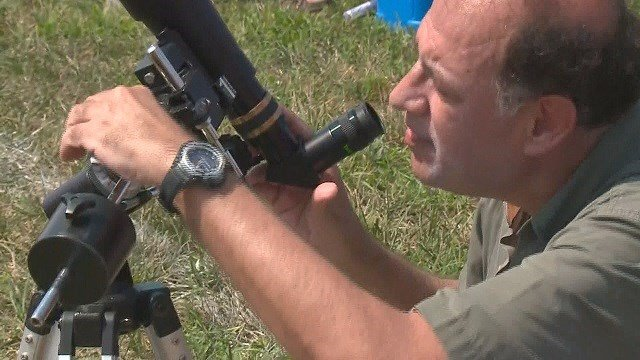 Amateur astronomer taking in the solar eclipse. (Credit: KMOV)