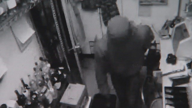 The crime was easy to see on surveillance video: a burglar riffling through the back office, stuffing cash into his pockets and then trying to open cash boxes by slamming them on the ground. (Credit: Retreat Gastropub)