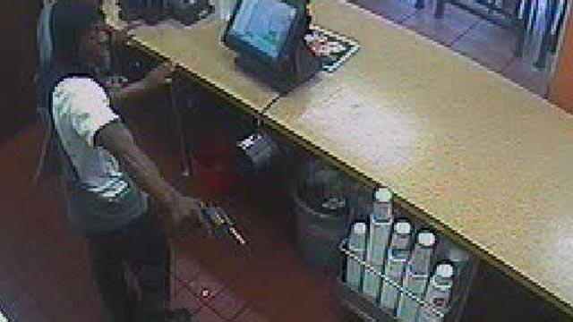 The suspect was seen on surveillance robbing a Jack in the Box on South Grand Tuesday (Credit: St. Louis Police)