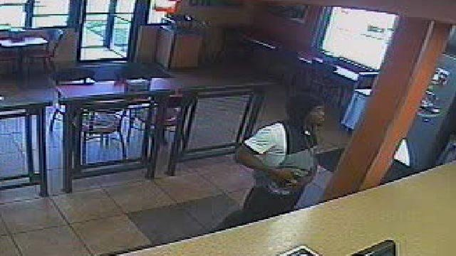 Armed robbery suspect captured on surveillance video (Credit: St. Louis Police)