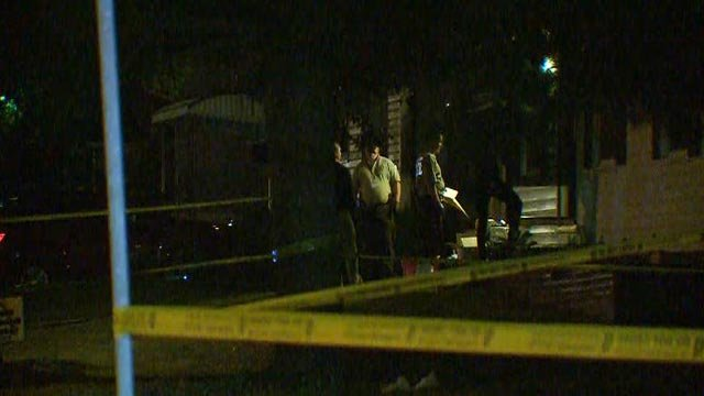 Investigators outside a home in the 10400 block of Balmoral Drive after four people were found dead late Thursday night (Credit: KMOV)