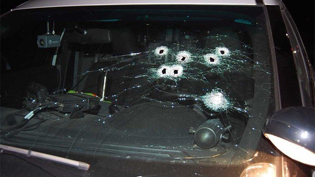 The police officer's car after shots were fired during the chase. (KMOV)