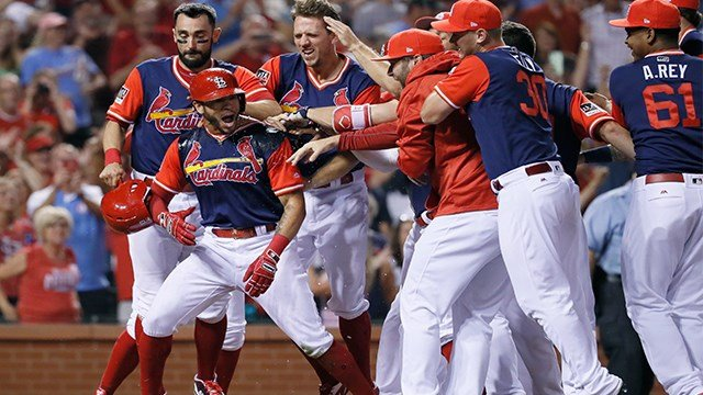 St. Louis Cardinals' Tommy Pham, second from left, is is congratulated by teammates after hitting a walk-off home run to defeat the Tampa Bay Rays in a baseball game Saturday, Aug. 26, 2017, in St. Louis. (AP Photo/Jeff Roberson)