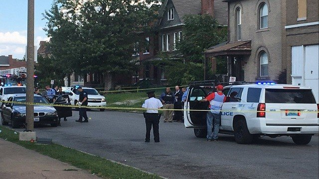 Officers on scene of a shooting on Page in St. Louis Tuesday afternoon (KMOV)