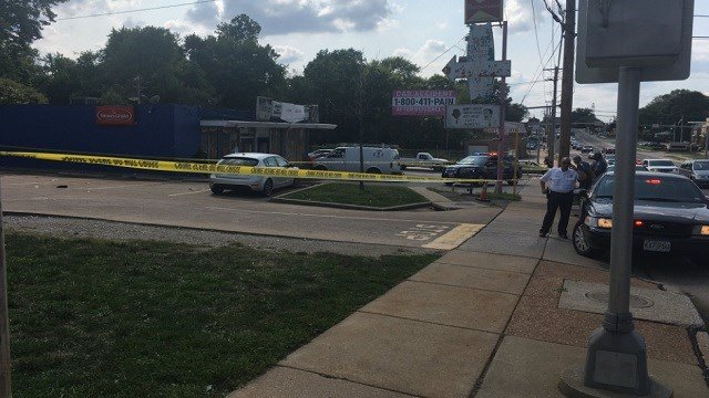 Police on scene of a shooting outside of the Liquor Doctor in the 8300 Berkeley (KMOV)