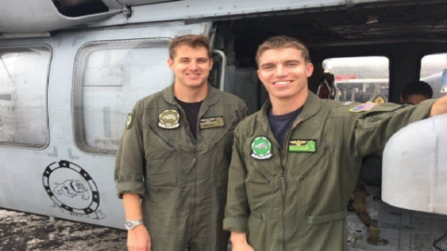 Navy helicopter pilots Steve Rosner and Tony Arrow have been helping rescue victims of Hurricane Harvey. Credit: @OmarVillafranca