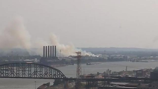 Smoke from a mulch pile fire was seen in downtown St. Louis Monday (Credit: KMOV)