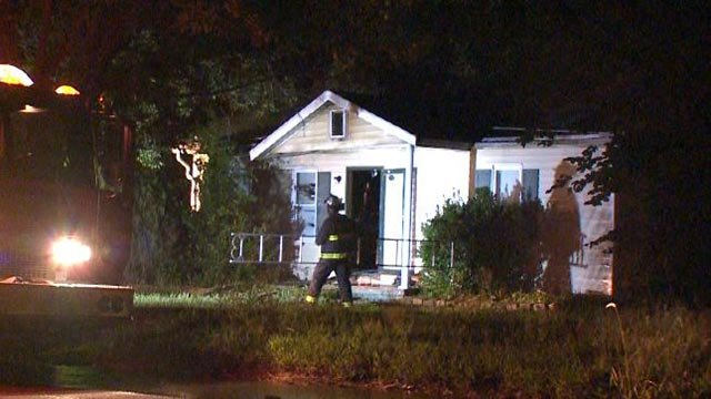 Firefighters outside a home in East St. Louis following an early morning fire Tuesday (Credit: KMOV)
