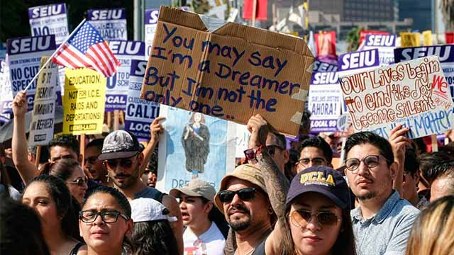 Supporters of DACA chant slogans and hold signs while joining a Labor Day rally in downtown Los Angeles on Monday, Sept. 4, 2017. (AP Photo/Richard Vogel)