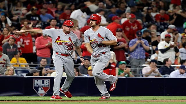 St. Louis Cardinals' Stephen Piscotty, right, is greeted by St. Louis Cardinals third base coach Mike Shildt after hitting a two-run home run during the seventh inning of a baseball game against the San Diego Padres (Credit: AP Photo / Gregory Bull)