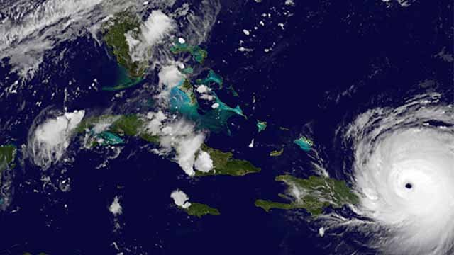 In this satellite image released by NASA/NOAA GOES Project, Hurricane Irma reaches Puerto Rico on Wednesday, Sept. 6, 2017. (NASA/NOAA GOES Project via AP)