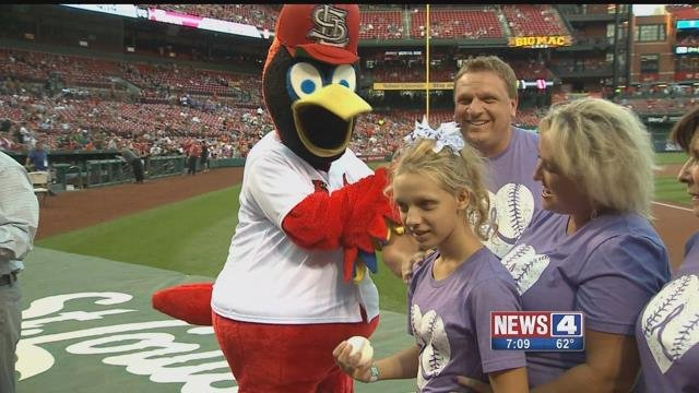 Payton Davison (center), a 13-year-old girl battling a rare neurological condition, got to throw out the ceremonial first pitch at Busch Stadium on Friday, September 8, 2017 (Credit: KMOV)