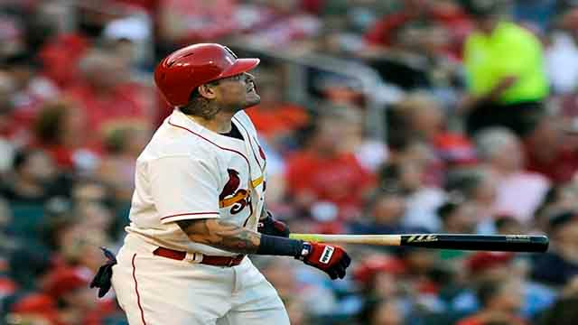 St. Louis Cardinals' Yadier Molina (4) watches a two run home run against the Pittsburgh Pirates' in the second inning of a baseball game, Saturday, Sept.9, 2017, at Busch Stadium in St. Louis. (AP Photo/Bill Boyce)