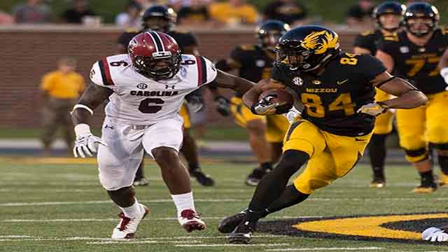 Missouri wide receiver Emanuel Hall, right, runs past South Carolina's T.J. Brunson, left, during the second quarter of an NCAA college football game Saturday, Sept. 9, 2017, in Columbia, Mo. (AP Photo/L.G. Patterson)
