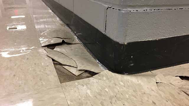 Areas of Wolf Branch Middle School including the gym and cafeteria are closed after it appears the ground underneath is moving. Credit: KMOV