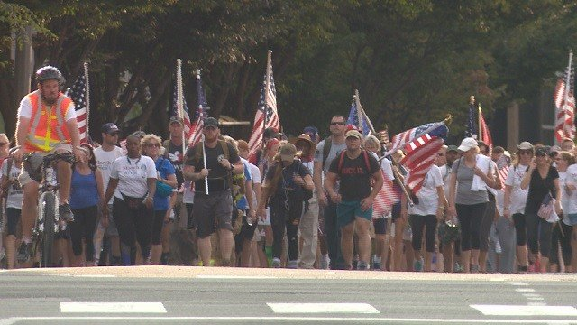 Participants marched to the St. Louis Arch as a part of a freedom march that began at 9:11 am. (Credit: KMOV)