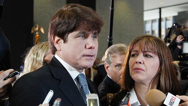 In this Dec. 7, 2011 file photo, former Illinois Gov. Rod Blagojevich, left, speaks to reporters as his wife, Patti, listens at the federal building in Chicago. (Credit: AP Photo / M. Spencer Green, File)