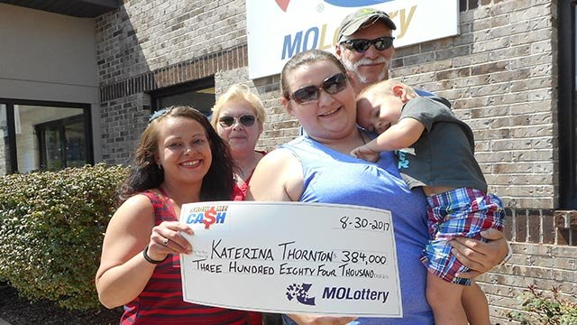 Katerina Thornton is seen in the blue shirt (Credit: Missouri Lottery)