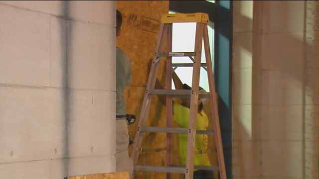 News 4 has learned that contractors boarded up three local Sprint stores Thursday. Credit: KMOV