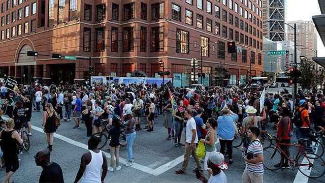 Protesters gather outside of the courthouse, Friday, Sept. 15, 2017, in downtown St. Louis.  (AP Photo/Jeff Roberson)