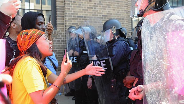 : A woman confronts police as protestors demonstrate through the city streets following a not guilty verdict on September 15, 2017 in St. Louis, Missouri.  (Getty Images)