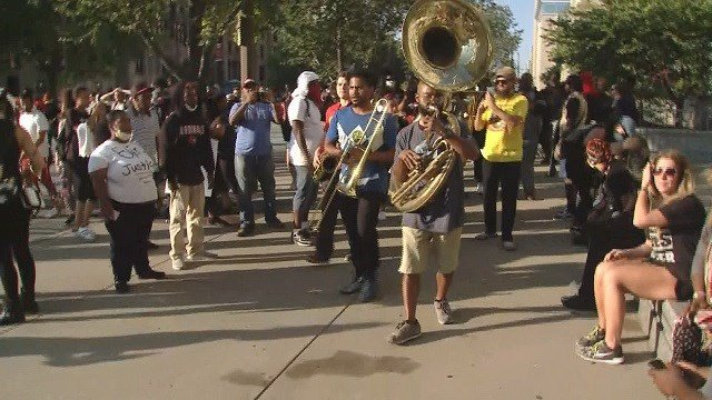 A musical band broke out among protests in St. Louis Friday.