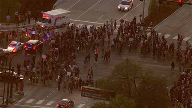 Protesters marching near the intersection of Kingshighway and Forest Park Parkway. Credit: KMOV