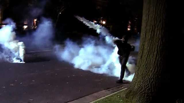 A protester throws a tear gas canister during a protest in the Central West End Friday night after the Jason Stockley verdict is announced. Credit: KMOV