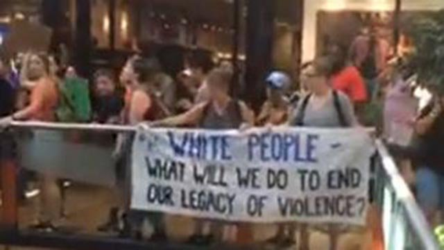 Protesters hung this sign over a railing at West County Mall in response to the Jason Stockley verdict (Credit: Marielle Mohs, KMOV